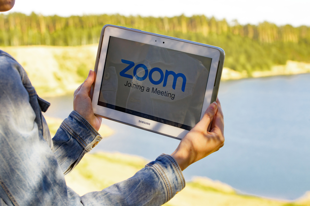 Zoom call, tablet, outdoors, beautiful lake