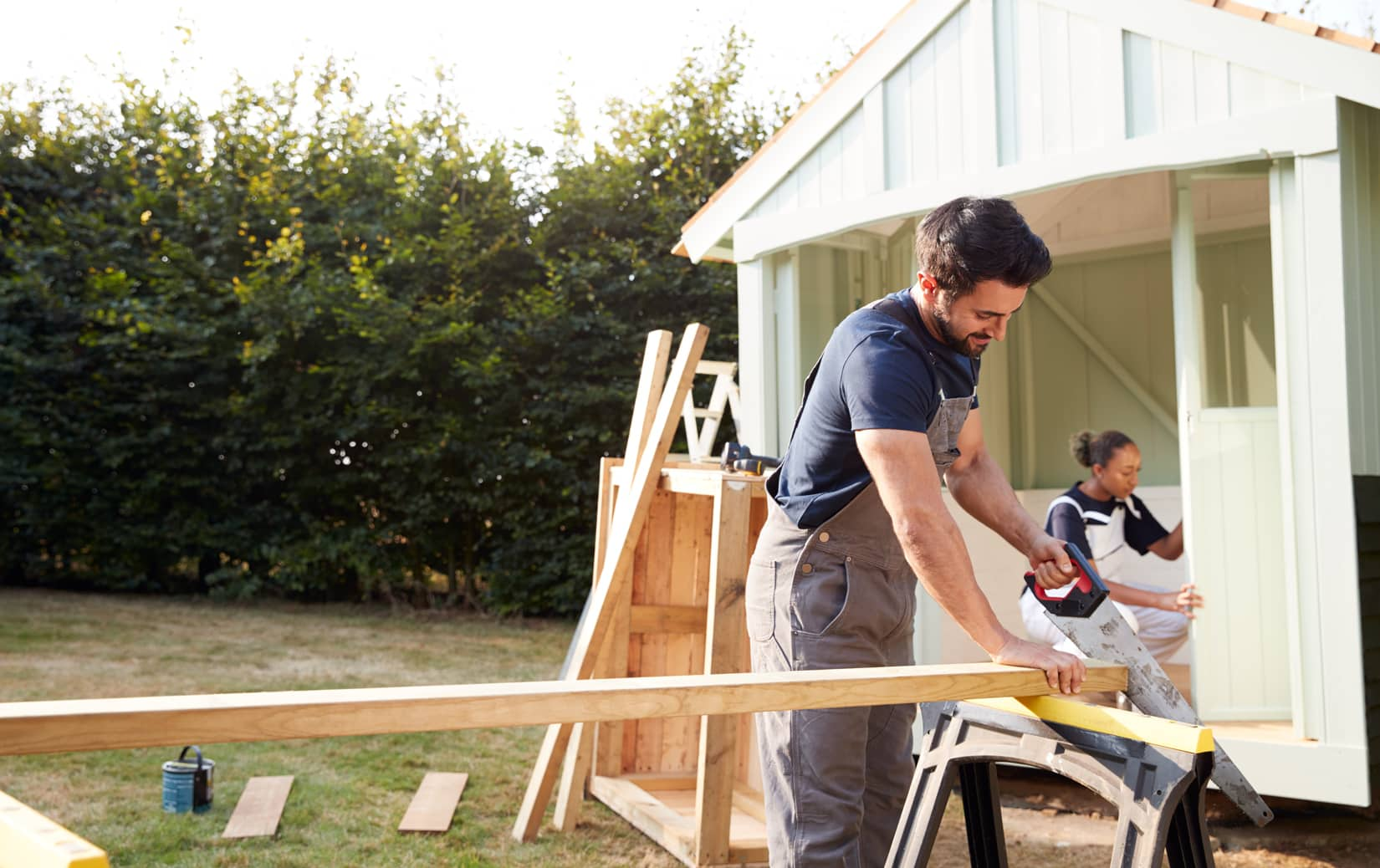 couple making home improvements, house flipping, real estate