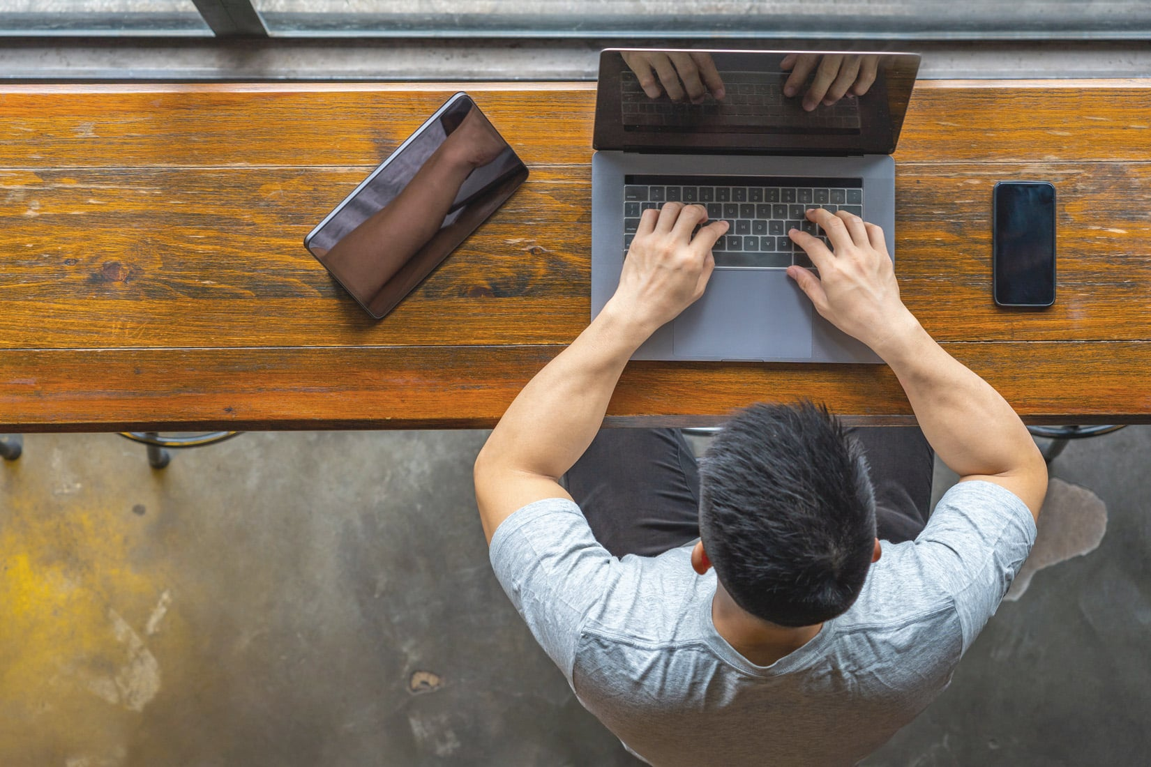 man at laptop with smartphone, loan application, real estate