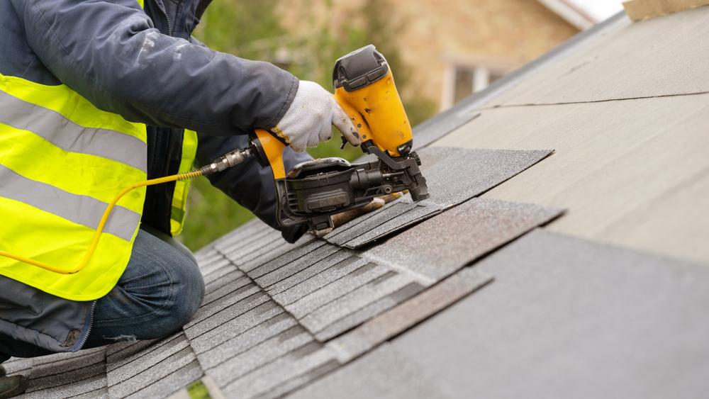 Roof repair, man replacing roof